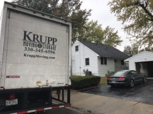 Back of Krupp moving truck in front of a garage