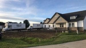 Two trucks in driveway of house