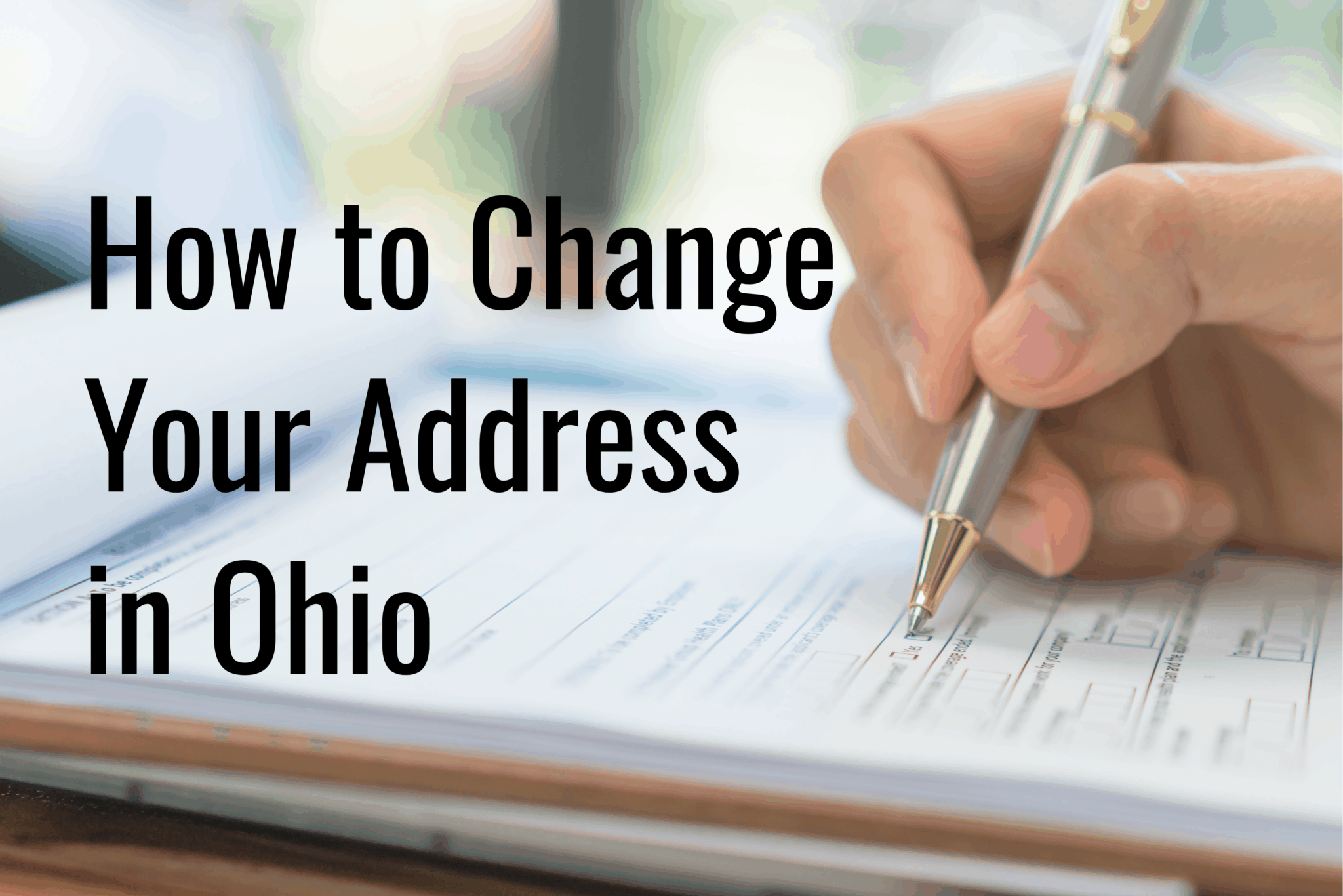 Person filling out a change of address form.