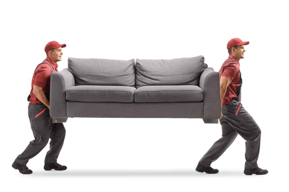 Professional movers lifting a couch.