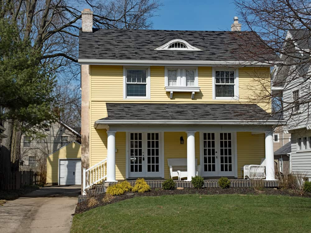 1920's style home with a beautiful porch and large yard.