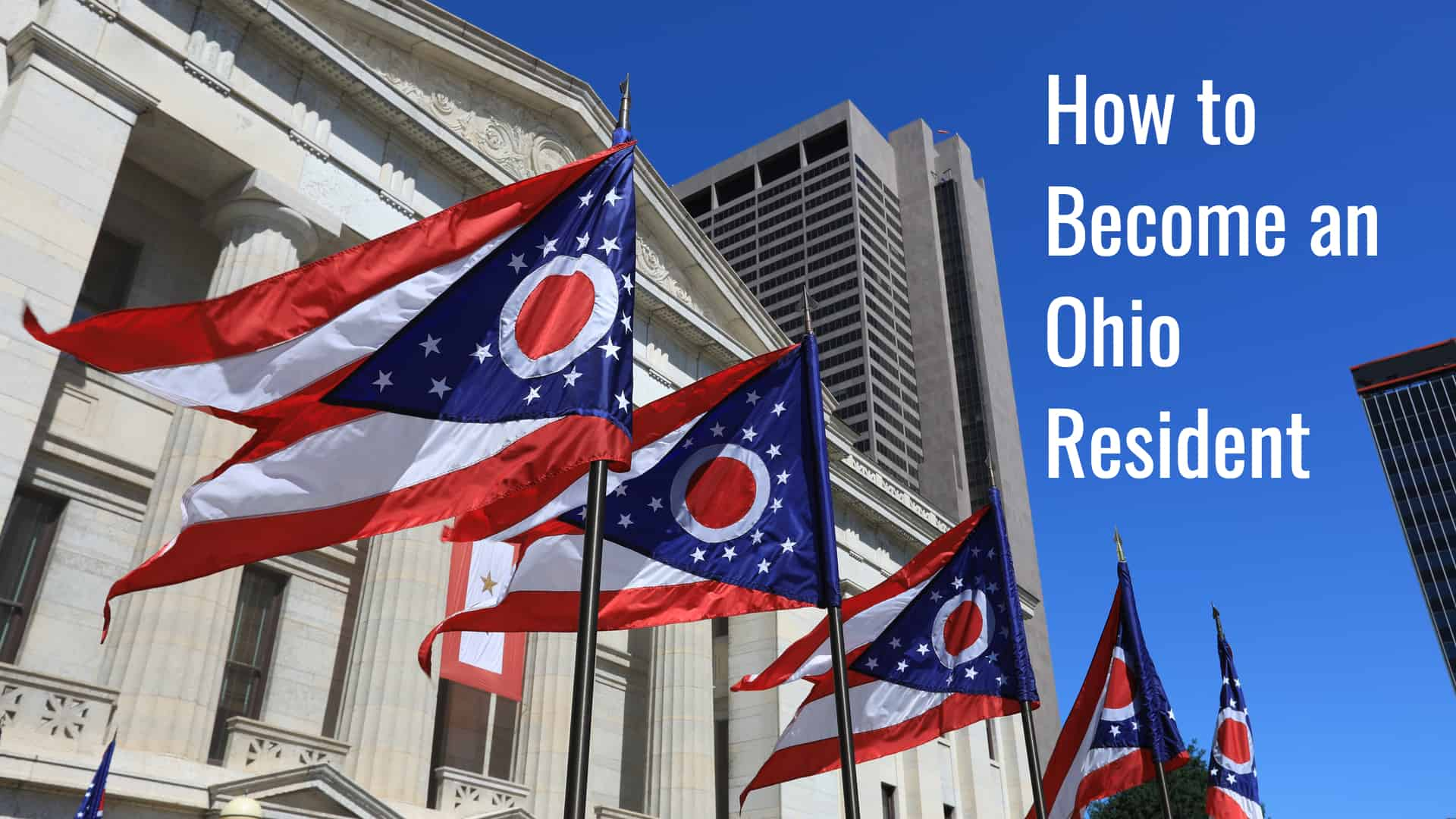 Ohio state flags waving in front of the statehouse.