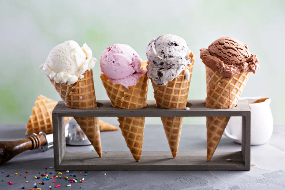 Four ice cream cones with multiple flavors